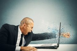 Man Punching the Laptop Blog image | TTR Data Recovery
