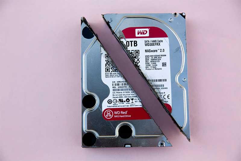 A broken hard drive sliced in half