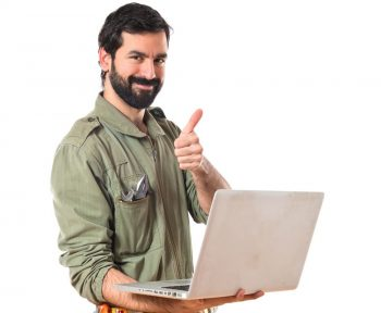 mechanic with laptop over white background | TTR Data Recovery